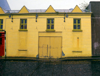 JOHN DOHERTY ~ The Yellow House - acrylic on canvas - 51 x 66 cm - POA